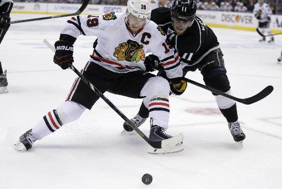 Chicago Blackhawks center Jonathan Toews, left, battles Los Angeles Kings center Anze Kopitar for the puck during first period of Game 6 of the Western Conference finals of the NHL hockey Stanley Cup playoffs in Los Angeles. Friday, May 30, 2014