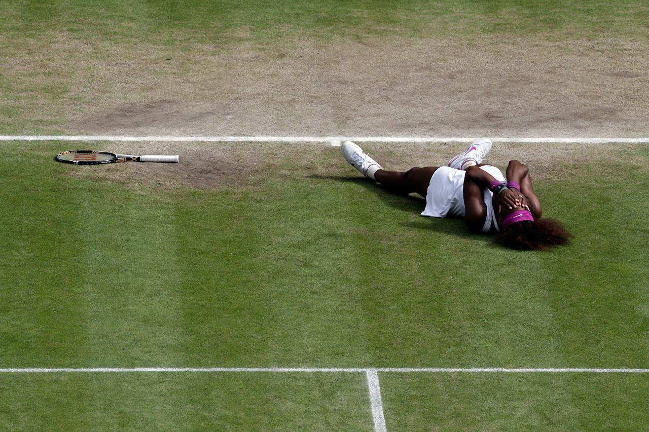 LONDON, ENGLAND - JULY 07:  Serena Williams of the USA celebrates match point during her Ladies? Singles final match against Agnieszka Radwanska of Poland on day twelve of the Wimbledon Lawn Tennis Championships at the All England Lawn Tennis and Croquet Club on July 7, 2012 in London, England.  (Photo by Anja Niedringhaus/Pool/Getty Images)