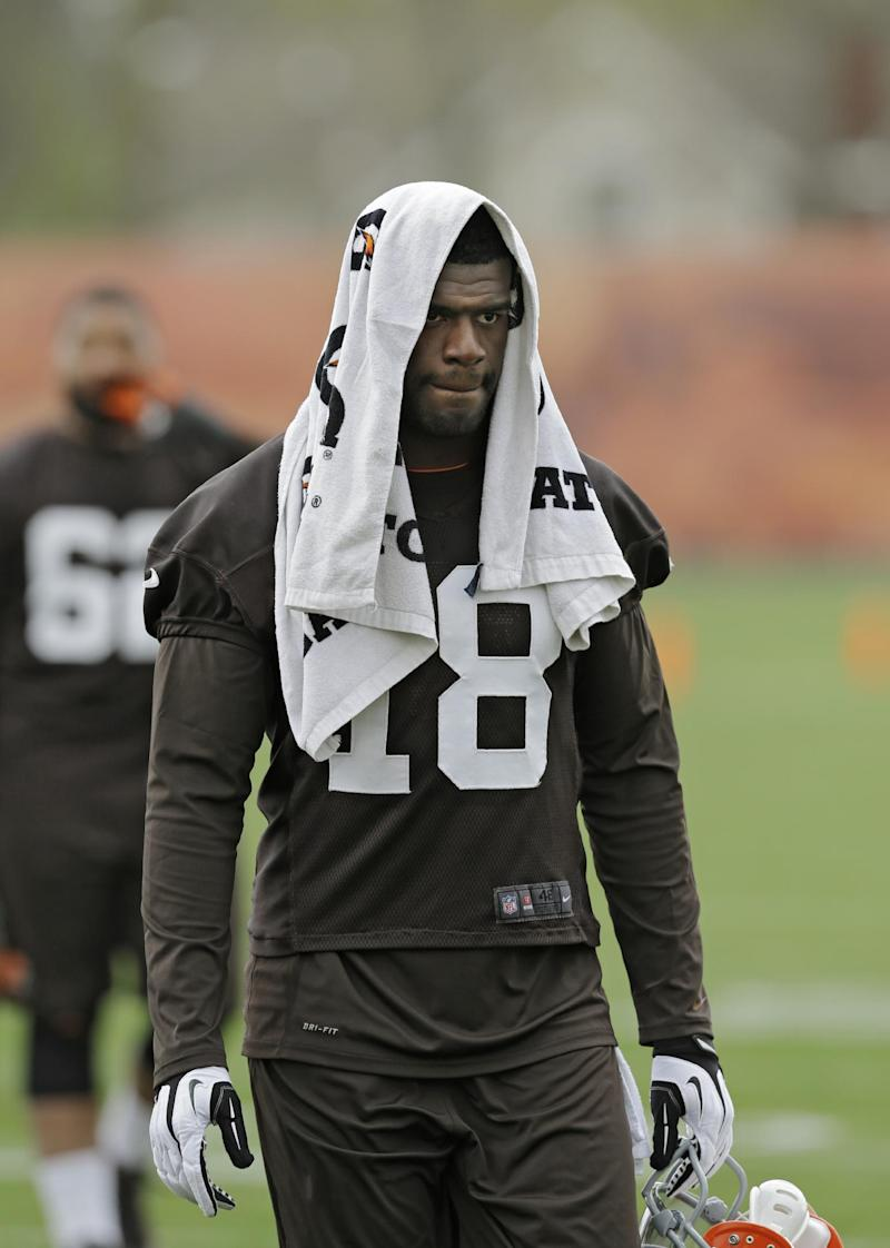 In this May 1, 2014, file photo, Cleveland Browns wide receiver Greg Little walks off the field after a voluntary minicamp workout at the NFL football team's facility in Berea, Ohio. The Browns have released the inconsistent wide receiver on Friday, May 16, 2014