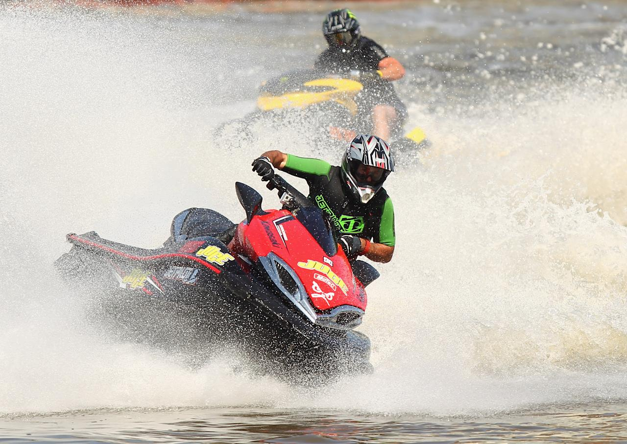 Jet ski riders perform as part of the Moomba Festival on the Yarra River on March 11, 2012 in Melbourne, Australia.  (Photo by Robert Cianflone/Getty Images)
