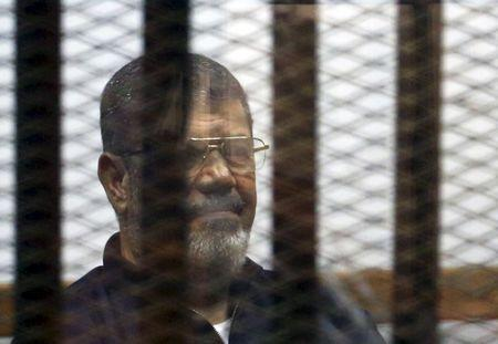 Egypt court quashes one of Morsi life sentences: lawyer