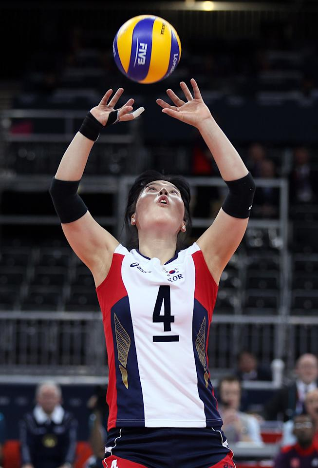 LONDON, ENGLAND - JULY 28:  Sa-Nee Kim #4 of Korea sets the ball in the second set against United States during Women's Volleyball on Day 1 of the London 2012 Olympic Games at Earls Court on July 28, 2012 in London, England.  (Photo by Elsa/Getty Images)