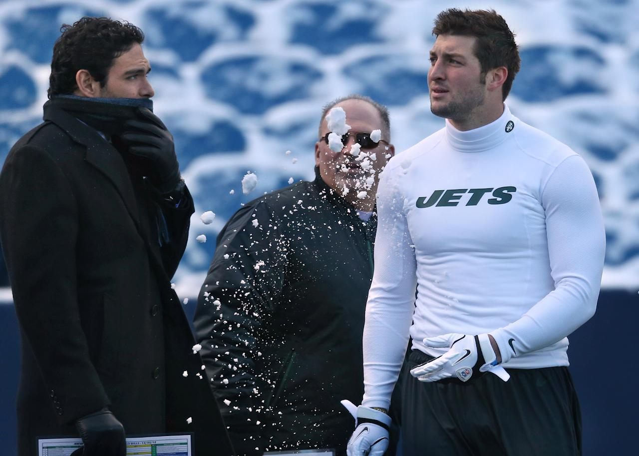 ORCHARD PARK, NY - DECEMBER 30: Tim Tebow #15 of the New York Jets throws snow in the direction of Mark Sanchez #6 as offensive coordinator Tony Sparano looks on before their NFL game against the Buffalo Bills at Ralph Wilson Stadium on December 30, 2012 in Orchard Park, New York. (Photo by Tom Szczerbowski/Getty Images)