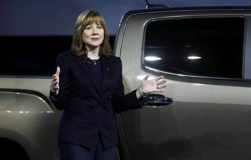 Mary Barra, incoming CEO of General Motors Co., reveals the 2015 GMC Canyon pickup truck in an industrial building in advance of the media preview of the North American International Auto Show in Detroit,