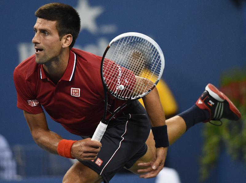 Novak Djokovic of Serbia serves to Diego Schwartzman of Argentina during their US Open 2014 men's singles match at the USTA Billie Jean King National Center August 25, 2014 in New York