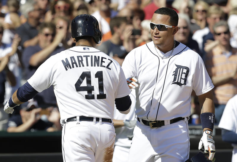 Suarez leads Tigers to 12-9 victory over Twins