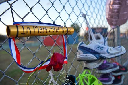 A memorial is seen on the campus of Lafayette High School for Trinity Gay, the daughter of Olympic sprinter Tyson Gay, who died in an exchange of gunfire early Sunday morning, in Lexington, Kentucky, October 17, 2016.  REUTERS/Bryan Woolston