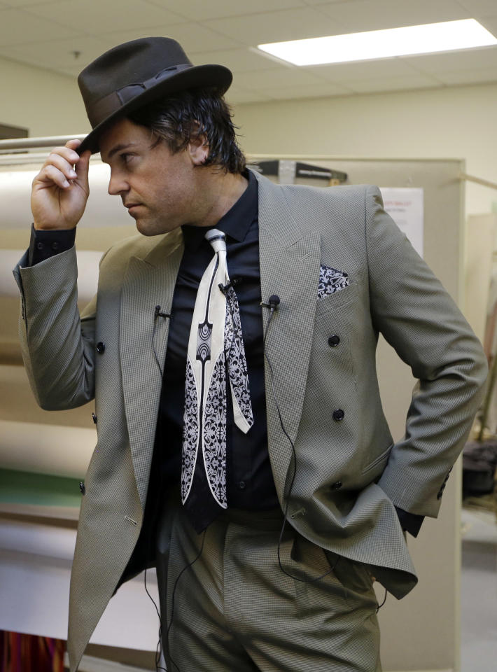 """Mike Piazza, former MLB baseball player, strikes a pose as he is fitted for his costume for his role in """"Slaughter on Tenth Avenue"""" at the Miami City Ballet, Tuesday, April 16, 2013, in Miami Beach, Fla. Piazza will play a gangster in the ballet on May 3. He will say a few lines and then watch the rest of the performance from a seat onstage. Piazza says his turn with the troupe is his gift to his 6-year-old daughter, a student at Miami City Ballet School. (AP Photo/Lynne Sladky)"""