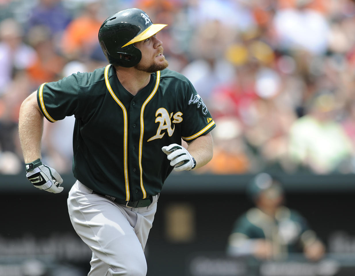 Oakland Athletic's Brandon Moss watches the flight of his grand slam against the Baltimore Orioles in the third inning of a baseball game, Sunday, June 8, 2014, in Baltimore. (AP Photo/Gail Burton)