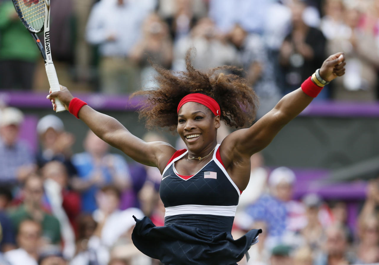 Serena Williams of the U.S. celebrates after winning the women's singles gold medal match against Russia's Maria Sharapova at the All England Lawn Tennis Club during the London 2012 Olympic Games August 4, 2012.           REUTERS/Stefan Wermuth (BRITAIN  - Tags: OLYMPICS SPORT TENNIS)