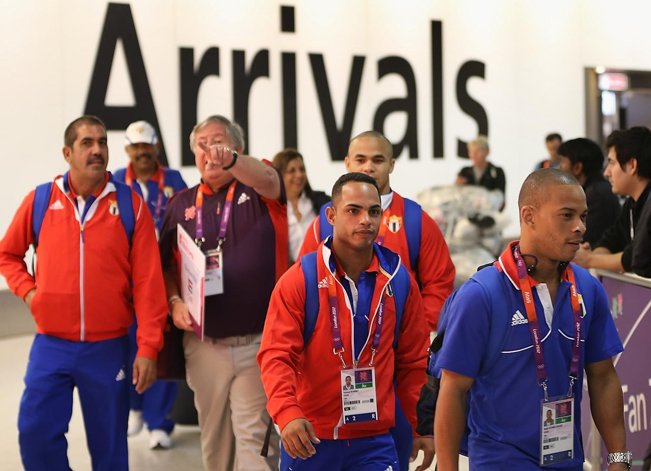 Members of the Cuban Olympic weightlifting team arrive at Heathrow Airport on July 16, 2012 in London, England. Athletes, coaches and Olympic officials are beginning to arrive in London ahead of the Olympics.  (Photo by Peter Macdiarmid/Getty Images)