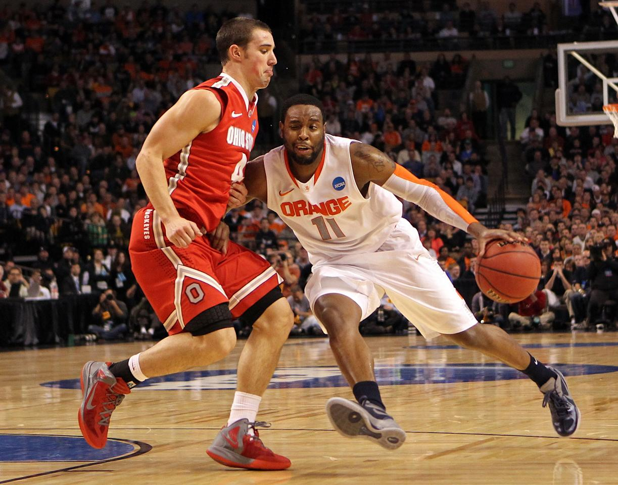 BOSTON, MA - MARCH 24:  Scoop Jardine #11 of the Syracuse Orange handles the ball against Aaron Craft #4 of the Ohio State Buckeyes during the 2012 NCAA Men's Basketball East Regional Final at TD Garden on March 24, 2012 in Boston, Massachusetts.  (Photo by Jim Rogash/Getty Images)