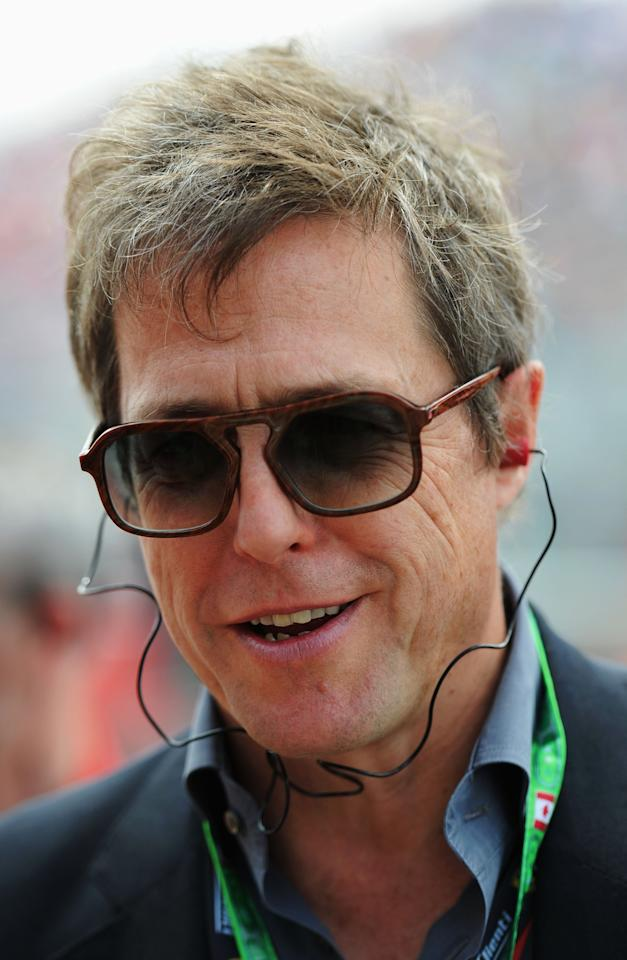 MONTREAL, QC - JUNE 09:  Actor Hugh Grant is seen on the grid before the Canadian Formula One Grand Prix at the Circuit Gilles Villeneuve on June 9, 2013 in Montreal, Canada.  (Photo by Shaun Botterill/Getty Images)