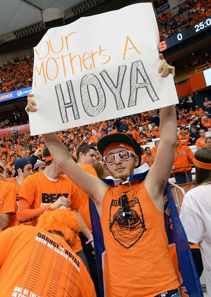 Syracuse fan Max Lefkowitz holds a sign Syracuse's NCAA college basketball game against Georgetown in Syracuse, N.Y., Saturday, Feb. 23, 2013.