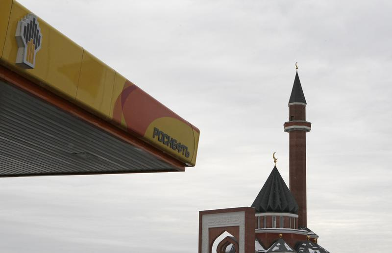 Mosque is seen next to company logo on a Rosneft petrol station in Moscow