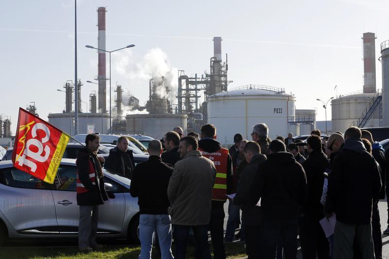 Striking union workers of French oil giant Total gather in front of the oil refinery of Donges