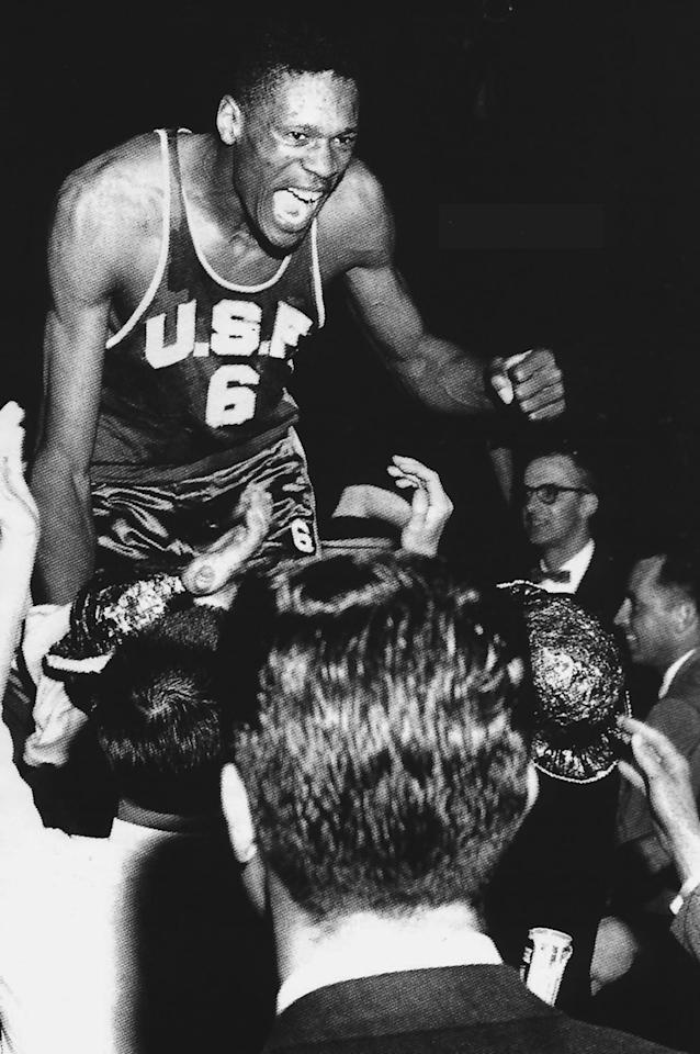 Bill Russell #6 center of the San Franisco University Dons men's basketball team celebrates with fans. (Photo by San Fransisco/Collegiate Images/Getty Images)