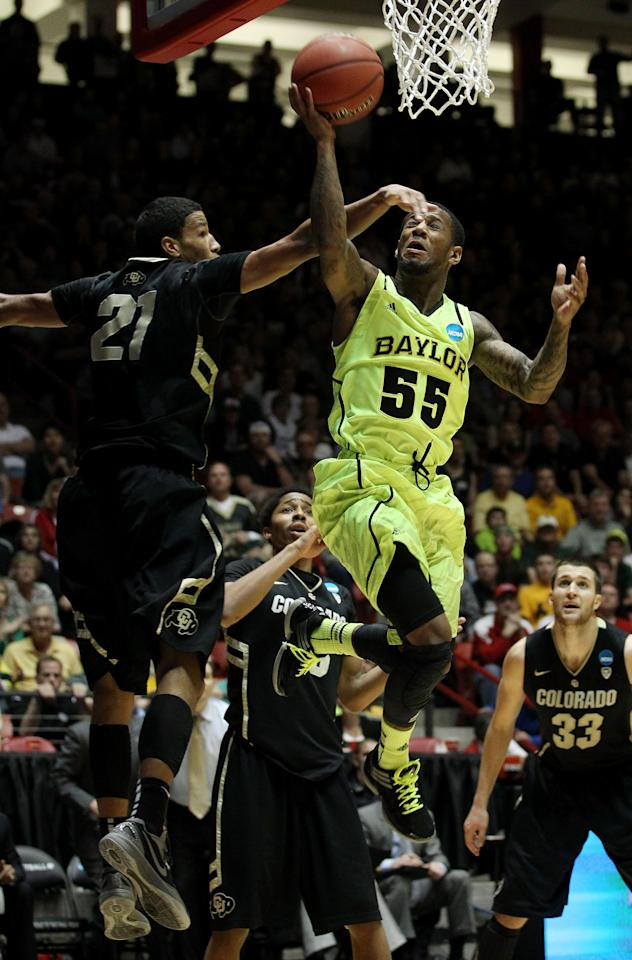 ALBUQUERQUE, NM - MARCH 17:  Pierre Jackson #55 of the Baylor Bears shoots against Andre Roberson #21 of the Colorado Buffaloes in the second half of the game during the third round of the 2012 NCAA Men's Basketball Tournament at The Pit on March 17, 2012 in Albuquerque, New Mexico.  (Photo by Christian Petersen/Getty Images)