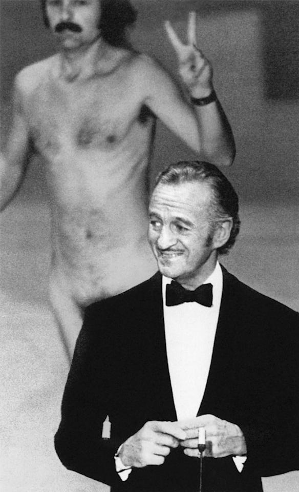 """The streaker (1974): Just as host David Niven was about to introduce Elizabeth Taylor, a naked man came running across the stage behind him, flashing a peace sign. (It was the '70s.) The whole place naturally went wild with laughter, but Niven, being the epitome of British class and cool, didn't miss a beat. He deadpanned: """"Well, ladies and gentlemen, that was almost bound to happen. But isn't it fascinating to think that probably the only laugh that man will ever get in his life is by stripping off and showing his shortcomings?"""""""