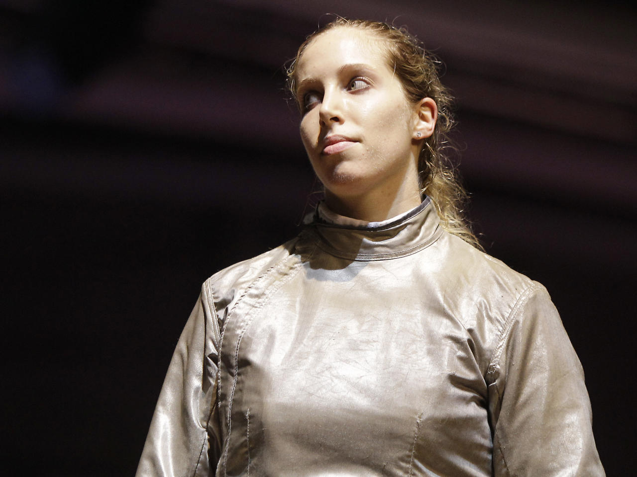 Mariel Zagunis, of the United States, reacts after losing against Russia's Velikaia Sophia during a women's team saber qualifying match at the World Fencing Championship in Catania, Italy, Saturday, Oct. 15, 2011. (AP Photo/Antonio Calanni)