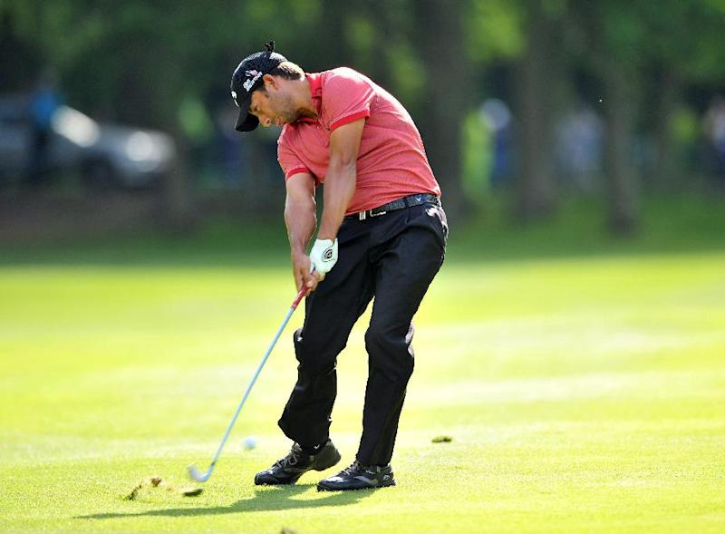 Spanish golfer Pablo Larrazabal plays his approach shot at Wentworth Golf Club in Surrey, England, on May 25, 2014