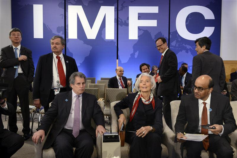 Lagarde takes her seat as she joins Lipton and Shanmugaratnam as they wait for the start of the IMFC meeting during the IMF and World Bank's 2014 Annual Spring Meetings in Washington