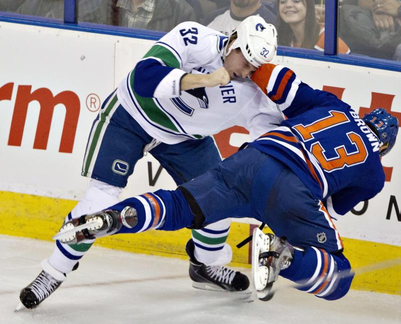 Perron leads Oilers to 5-2 win over Canucks