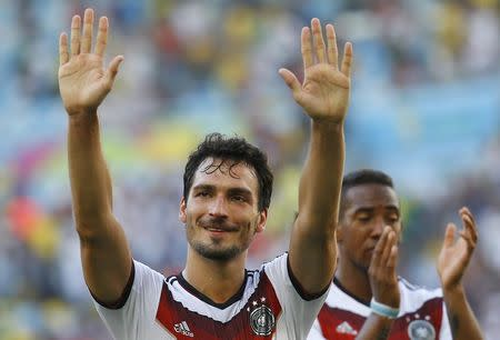 Germany's Hummels gestures in front of teammate Boateng as they celebrate their win over France after their 2014 World Cup quarter-finals at the Maracana stadium in Rio de Janeiro