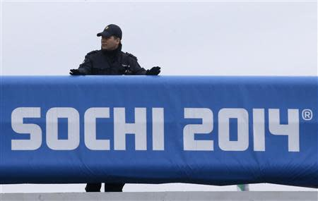 A Russian police officer keeps watch at the Olympic Park in the Adler district of Sochi