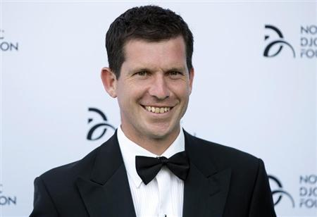 Former tennis player Tim Henman poses for photographers as he arrives at a fundraising dinner for the Novak Djokovic Foundation in London