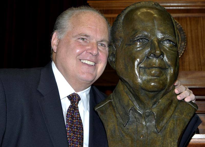 Conservative commentator Rush Limbaugh poses with a bust in his likeness during a secretive ceremony inducting him into the Hall of Famous Missourians on Monday, May 14, 2012, in the state Capitol in Jefferson City,  Mo. (AP Photo/Julie Smith)