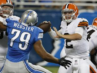 Johnny Manziel (2) is pressured by Lions DE Larry Webster in the second half of Saturday's game. (AP)