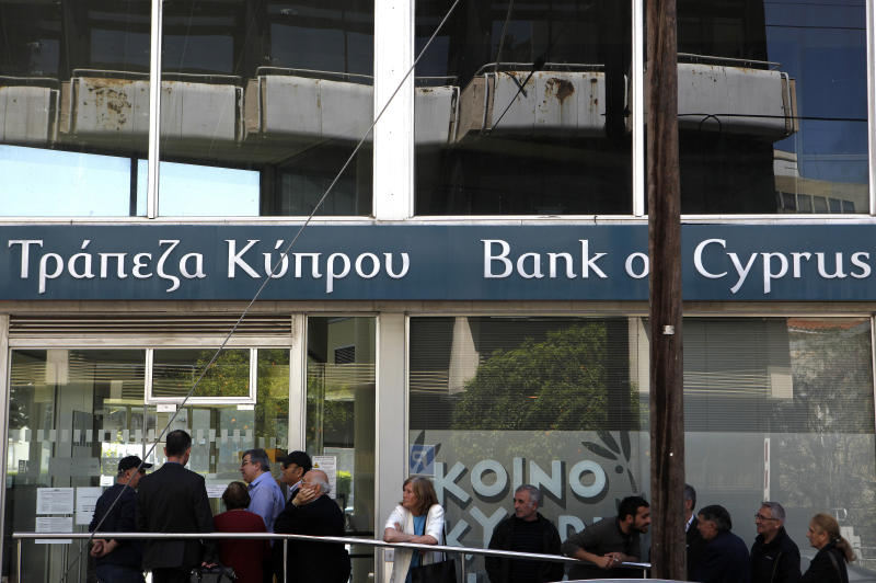 Cypriots anxious as banks reopen with limits