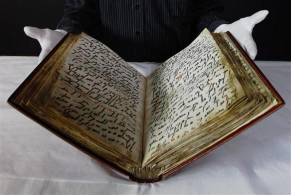 "Senior Conservator of the British Library David Jacobs displays the library's 8th century Ma'il Qu'ran, one of the earliest in existence, during a media event at the British Museum in London January 13, 2012. The manuscript will go on public display as part of the exhibition ""Hajj: journey to the heart of Islam"" which opens on January 26."