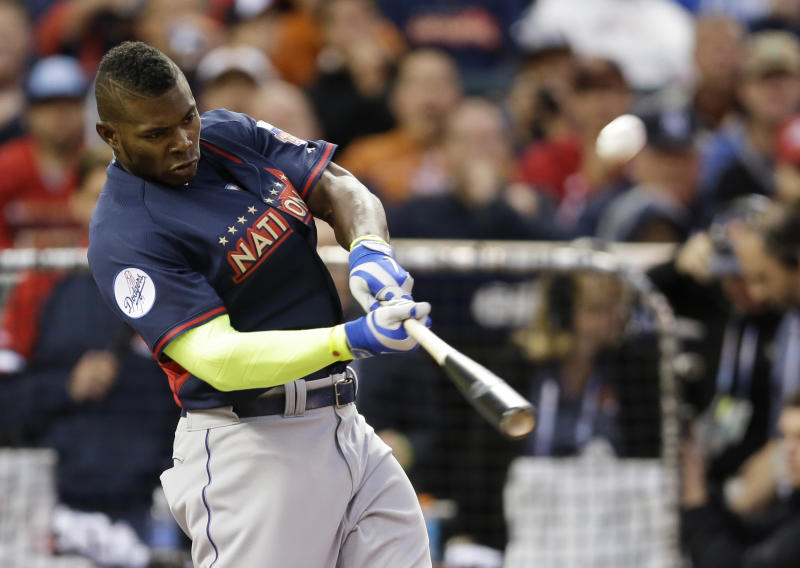 National League's Yasiel Puig, of the Los Angeles Dodgers, hits during the MLB All-Star baseball Home Run Derby, Monday, July 14, 2014, in Minneapolis. (AP Photo/Jeff Roberson)