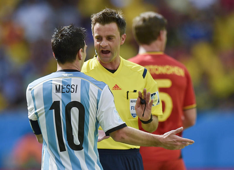 Referee Nicola Rizzoli of Italy speaks with Argentina's Lionel Messi during the World Cup quarterfinal soccer match between Argentina and Belgium at the Estadio Nacional in Brasilia, Brazil, Saturday, July 5, 2014