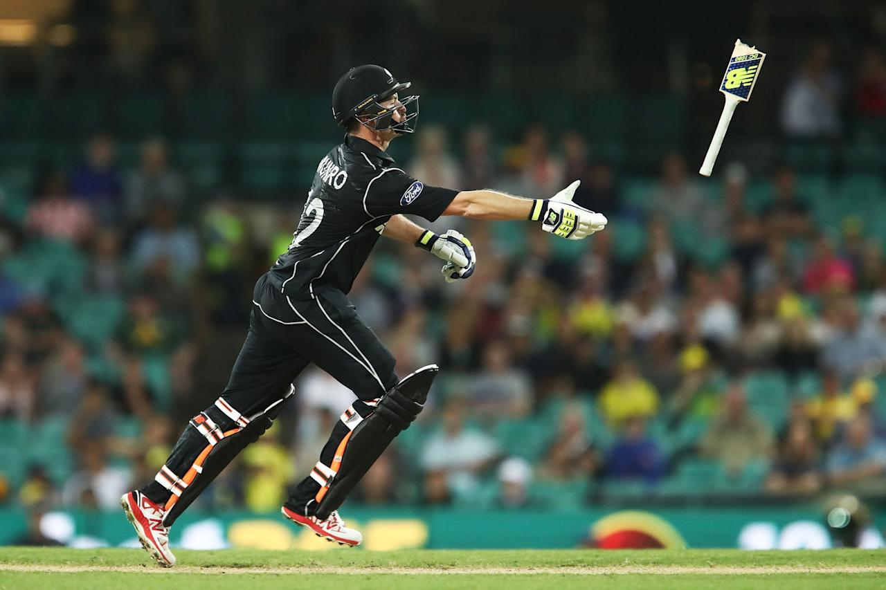 <p>Colin Munro of New Zealand throws his broken bat handle during game one of the One Day International series between Australia and New Zealand at Sydney Cricket Ground on December 4, 2016 in Sydney, Australia. </p>