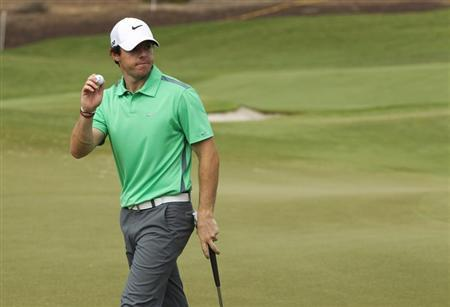 McIlroy of Northern Ireland holds his ball on the second green during the third round of the DP World Tour Championship in Dubai