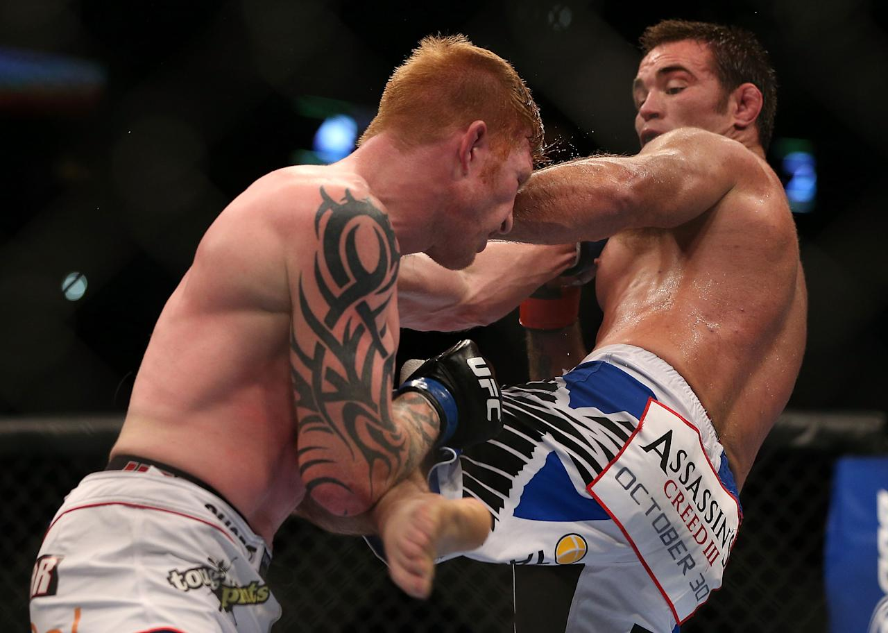 Jake Shields kicks Ed Herman during their middleweight bout at UFC 150 inside Pepsi Center on August 11, 2012 in Denver, Colorado. (Photo by Josh Hedges/Zuffa LLC/Zuffa LLC via Getty Images)