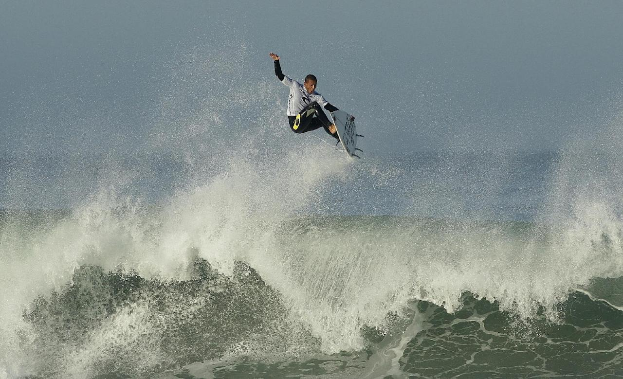 Surfer Jadson Andre, from Brazil, competes in the Rip Curl Pro Search 2011 surf contest at Ocean Beach in San Francisco, Tuesday, Nov. 1, 2011. (AP Photo/Jeff Chiu)