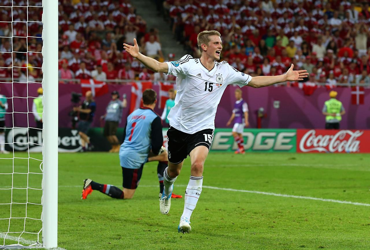 L'VIV, UKRAINE - JUNE 17:  Lars Bender of Germany celebrates scoring their second goal during the UEFA EURO 2012 group B match between Denmark and Germany at Arena Lviv on June 17, 2012 in L'viv, Ukraine.  (Photo by Martin Rose/Getty Images)