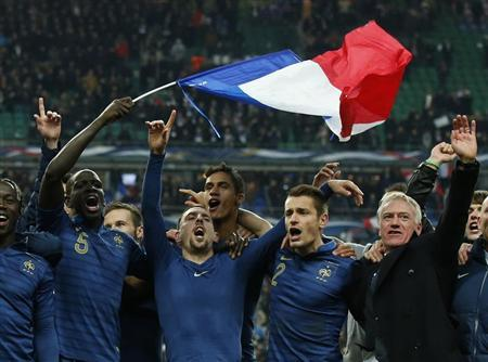 France's soccer team coach Deschamps and team mates celebrate after winning their 2014 World Cup qualifying second leg playoff soccer match against Ukraine at the Stade de France in Saint-Denis near Paris