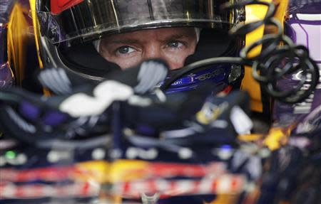 Red Bull Formula One driver Vettel sits in his car during the second practice session of the Italian F1 Grand Prix at the Monza circuit