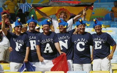 French and German fans pose for the camera before the start of the 2014 World Cup quarter-finals between France and Germany at the Maracana stadium in Rio de Janeiro