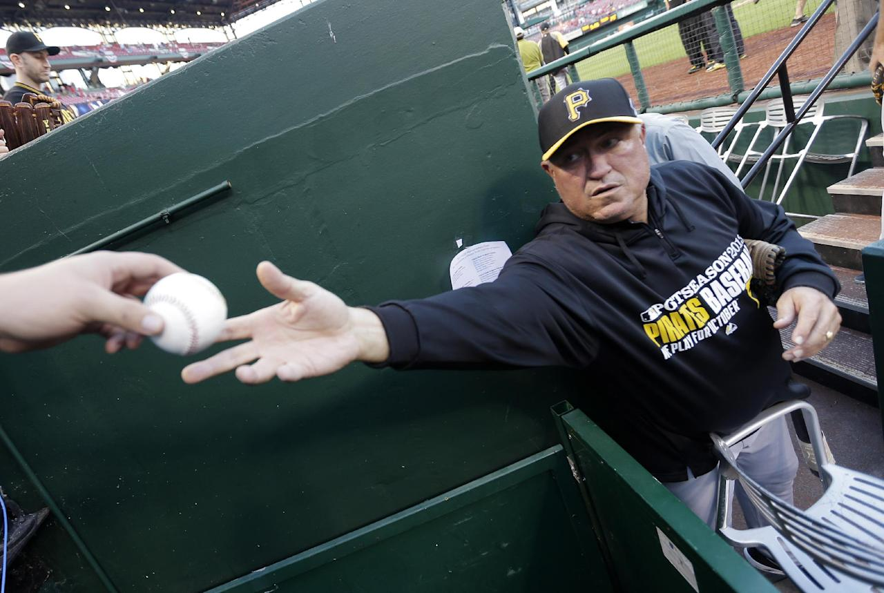 Pittsburgh Pirates manager Clint Hurdle signs autographs before Game 5 of a National League baseball division series between the Pirates and the St. Louis Cardinals on Wednesday, Oct. 9, 2013, in St. Louis. (AP Photo/Charlie Riedel)