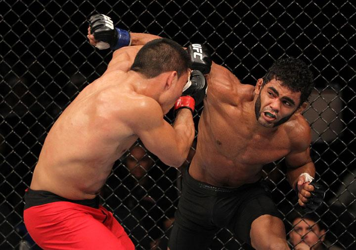 "BELO HORIZONTE, BRAZIL - JUNE 23:   (R-L) Hugo ""Wolverine"" Viana punches John Teixeira during their UFC 147 featherweight bout at Estadio Jornalista Felipe Drummond on June 23, 2012 in Belo Horizonte, Brazil."