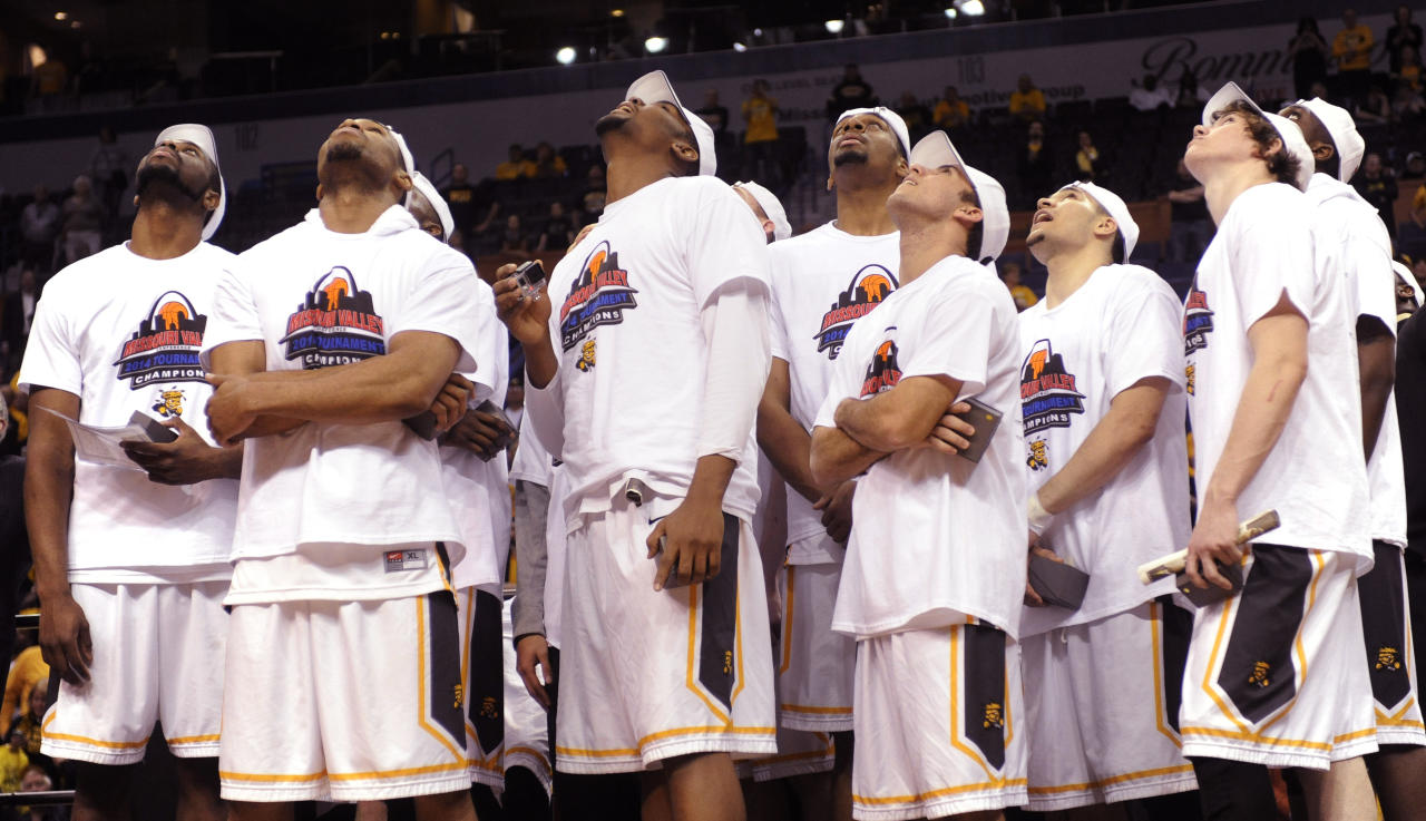 Wichita State players watch highlights of their victory over Indiana State on the overhead monitor in an NCAA college basketball game in the championship of the Missouri Valley Conference men's tournament, Sunday, March 9, 2014, in St. Louis. (AP Photo/Bill Boyce)