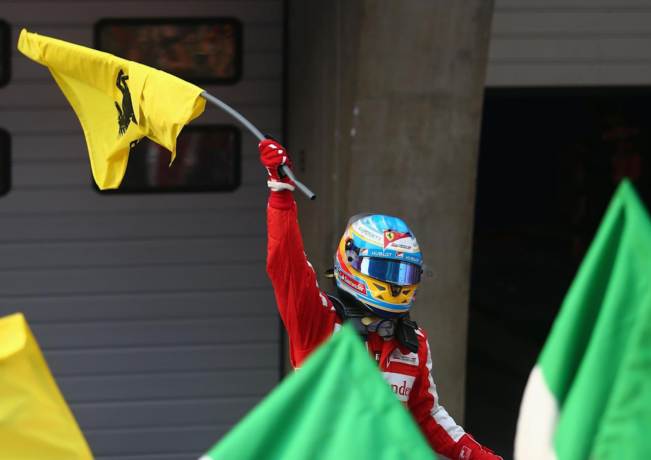 SHANGHAI, CHINA - APRIL 14:  Fernando Alonso of Spain and Ferrari celebrates in parc ferme after winning the Chinese Formula One Grand Prix at the Shanghai International Circuit on April 14, 2013 in Shanghai, China.  (Photo by Clive Mason/Getty Images)