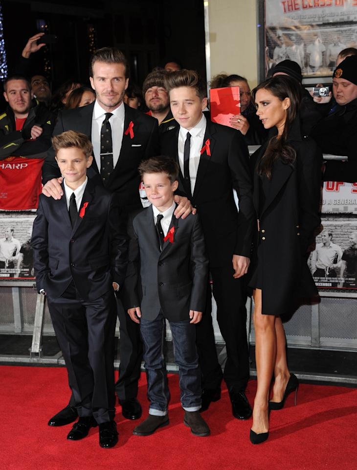"""LONDON, UNITED KINGDOM - DECEMBER 01: (L-R) Romeo Beckham, David Beckham, Cruz Beckham, Brooklyn Beckham and Victoria Beckham attend the World premiere of """"The Class of 92"""" at Odeon West End on December 1, 2013 in London, England. (Photo by Stuart C. Wilson/Getty Images)"""