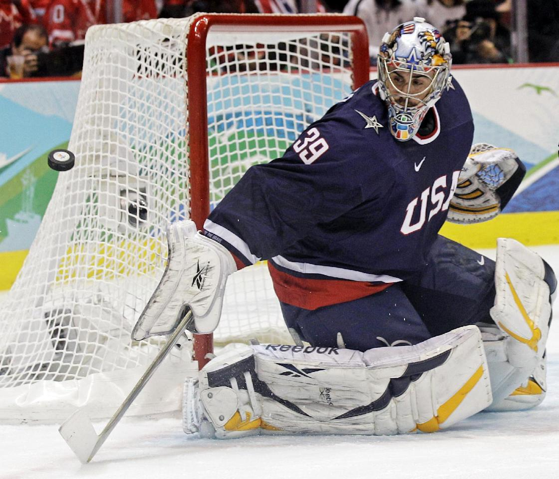 FILE - In this Feb. 28, 2010, file photo, USA goalie Ryan Miller (39) makes a save in the first period of the men's gold medal ice hockey game against Canada at the Vancouver 2010 Olympics in Vancouver, British Columbia. The Americans don't have incredible star power, but they're quite fast, and they might have the tournament's best goaltending combo in Ryan Miller and Jonathan Quick.  (AP Photo/Matt Slocum, File)